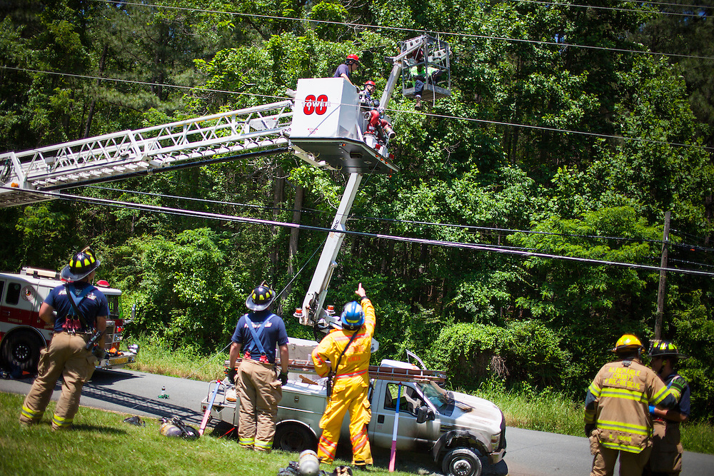 Fire department units from Albemarle County Fire Rescue, Crozet and Seminole Trail responded to the area of 3075 Morgantown Road in Ivy for a vehicle fire and special rescue. A bucket truck hit a power line, electrocuting the worker and starting the truck on fire.  Once power was turned off, Tower 88 from Seminole Trail was used to rescue the worker, who was burned.<br /> Photo by Justin Ide