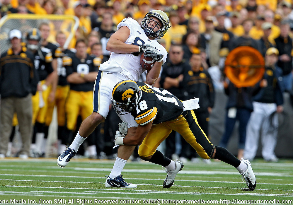 September 17, 2011: Pittsburgh Panthers wide receiver Mike Shanahan (87) pulls in a pass as he is hit by Iowa Hawkeyes cornerback Micah Hyde (18) during the second half of the game between the Iowa Hawkeyes and the Pittsburgh Panthers at Kinnick Stadium in Iowa City, Iowa on Saturday, September 17, 2011. Iowa defeated Pittsburgh 31-27.