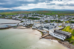Aerial view from drone of Bowmore Town and Bowmore scotch whisky distillery on Islay, Inner Hebrides , Scotland, UK