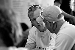 Ian Williams in conversation. Racing postponed due to lack of wind. Sailors Lounge. Korea Match Cup 2010. World Match Racing Tour. Gyeonggi, Korea. 10th June 2010. Photo: Ian Roman/Subzero Images.