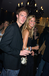 ALICE FERGUSON and SAM HOARE at a party to celebrate the publication of Tatler's Little Black Book 2005 held at the Baglioni Hotel, 60 Hyde Park Gate, London SW7 on 9th November 2005.<br />