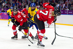 20.02.2014, Bolshoy Ice Dome, Adler, RUS, Sochi, 2014, Eishockey Damen, Spiel um die Bronzemedaille, im Bild Alina Mueller (SUI), Lara Stalder (SUI) gegen Jenni Asserholt (SWE) // during Womens Icehockey Match for Bronze Medal of the Olympic Winter Games Sochi 2014 at the Bolshoy Ice Dome in Adler, Russia on 2014/02/20. EXPA Pictures © 2014, PhotoCredit: EXPA/ Freshfocus/ Urs Lindt<br /> <br /> *****ATTENTION - for AUT, SLO, CRO, SRB, BIH, MAZ only*****