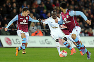 Swansea's Modou Barrow (c) attacks the Villa defence. Barclays Premier league match, Swansea city v Aston Villa at the Liberty Stadium in Swansea, South Wales on Saturday 19th March 2016.<br /> pic by  Carl Robertson, Andrew Orchard sports photography.