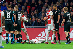Hakim Ziyech #22 of Ajax and Ramon Leeuwin #27 of AZ Alkmaar in action during the Dutch Eredivisie match round 25 between Ajax Amsterdam and AZ Alkmaar at the Johan Cruijff Arena on March 01, 2020 in Amsterdam, Netherlands