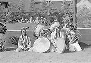 9305-B7048.  Four Indians at Opening of Bonneville Dam ceremonies, July 9 1938. (left to right) 1= Shu-Key Willie Spencer, 2= Chief Tommy Thompson, 3= Amos Simtustus, 4= ?. summary of event from The Dalles Weekly Chronicle: The official opening of the Port of The Dalles occurred when a flotilla of boats arrived at The Dalles dock. Visiting dignitaries stepped off the Onondaga and other vessels, official cars picked them up and transported them to the Union Pacific lawn just north of the chamber of commerce, where stood the 30-foot-high 'gateway to the Inland Empire'. An Indian wigwam was located nearby. At 4:30 the official ceremonies started. KOIN produced a 15 minute west-coast wide broadcast of a presentation hosted by announcer Stanley Church. prominent participants were Governor Charles Martin of Oregon, Governor Barilla Clark of Idaho and Governor Clarence Martin of Washington. Glenn Howell acted as commentator for the pageant.