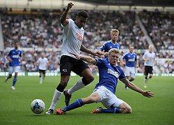 Derby County's Cyrus Christie is challenged - Photo mandatory by-line: Dougie Allward/JMP - Mobile: 07966 386802 30/08/2014 - SPORT - FOOTBALL - Derby - iPro Stadium - Derby County v Ipswich Town - Sky Bet Championship