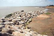 Rock armour barriers to control coastal erosion, Bawdsey, Suffolk, England