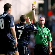 Referee P.Danson shows Sheffield Wednesday's Gerald Sibon (8) his second yellow card before showing the red