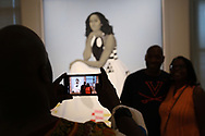 WASHINGTON - JUNE 29, 2019: Visitors look at a painting of the official portrait of First Lady Michelle Obama by artist Amy Sherald on June 29, 2019, at the National Portrait Gallery in Washington, D.C.