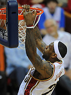 LeBron James scores an easy bucket against Detroit.