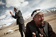 Er Ali Boi and his son Jim Boi, speaking on radio..Summer camp of Muqur, Er Ali Boi's place...Trekking through the high altitude plateau of the Little Pamir mountains (average 4200 meters) , where the Afghan Kyrgyz community live all year, on the borders of China, Tajikistan and Pakistan.
