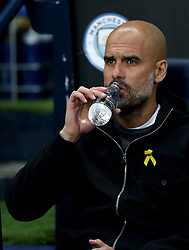 Manchester City manager Pep Guardiola takes a drink during the UEFA Champions League, Quarter Final at the Etihad Stadium, Manchester.