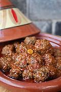 Moroccan meatballs in tomato sauce served in a Tagine (Tajine).