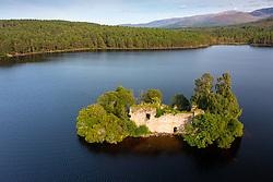 Aerial view from drone of ruin of Loch an Eilein Castle on Loch an Eilein in Rothiemurchus, Cairngorms National Park, Scotland UK
