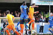 Karleigh Osborne of AFC Wimbledon jumps highest during the Sky Bet League 2 match between AFC Wimbledon and Wycombe Wanderers at the Cherry Red Records Stadium, Kingston, England on 21 November 2015. Photo by Stuart Butcher.