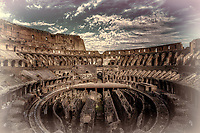"""""""Western entrance evening view of the Roman Colosseum - Tinto""""…<br /> <br /> The Colosseum, is an elliptical amphitheater in the center of the city of Rome, the largest ever built during the Roman Empire. It is considered one of the greatest works of Roman architecture and Roman engineering in history.  Occupying a site just east of the Roman Forum, its construction started in 72 AD under the emperor Vespasian and was completed in 80 AD under Titus. Capable of seating 65,000 spectators, it was used for gladiatorial contests and public spectacles such as mock sea battles, animal hunts, executions, re-enactments of famous battles, and dramas based on Classical mythology. The building ceased to be used for entertainment in the early medieval era. It is one of Rome's most popular tourist attractions and still, has close connections with the Roman Catholic Church, as each Good Friday the Pope leads torch lit """"Way of the Cross"""" procession that starts in the area around the Colosseum.  The Colosseum is generally regarded by Christians as a site of the martyrdom of large numbers of believers during the persecution of Christians in the Roman Empire, as evidenced by Church history and tradition.  A Cross stands exultant in the Colosseum center with a plaque stating:  """"The amphitheater, one consecrated to triumphs, entertainments, and the impious worship of pagan gods, is now dedicated to the sufferings of the martyrs purified from impious superstitions.""""  In viewing many historical sites during my journey in Italy, seeing the iconic Colosseum for the first time…I became awestruck.   It is as grand in person as it appears in the media, and it seems to hold a very mystical aura.  Climbing the ancient steps inside, one cannot help but feel not only the suffering of its past but the forgiveness and sacrifice of its present stature."""