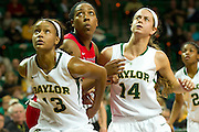 WACO, TX - DECEMBER 18: Nina Davis #13 and Makenzie Robertson #14 of the Baylor Bears box out against the Mississippi Lady Rebels on December 18 at the Ferrell Center in Waco, Texas.  (Photo by Cooper Neill) *** Local Caption *** Nina Davis; Makenzie Robertson