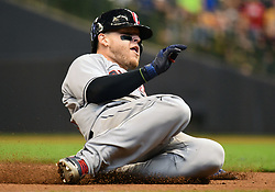 May 9, 2018 - Milwaukee, WI, U.S. - MILWAUKEE, WI - MAY 09: Cleveland Indians Catcher Roberto Perez (55) slides into 3rd for a triple during a MLB game between the Milwaukee Brewers and Cleveland Indians on May 9, 2018 at Miller Park in Milwaukee, WI.The Indians defeated the Brewers 6-2.(Photo by Nick Wosika/Icon Sportswire) (Credit Image: © Nick Wosika/Icon SMI via ZUMA Press)