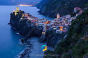 A view of the town of Vernazza, Italy photographed at blue hour.