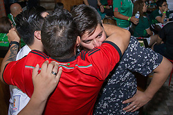 July 2, 2018 - FL, USA - Mexico fan Yeyo Cantu, right, gets a hug from his friends after Mexicos's loss to Brazil during the FIFA World Cup Round of 16 knockout stage at Vares in Brickell on Monday, July 2, 2018. (Credit Image: © Sam Navarro/TNS via ZUMA Wire)