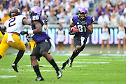 FORT WORTH, TX - SEPTEMBER 13:  Ja'Juan Story #81 of the TCU Horned Frogs breaks free against the Minnesota Golden Gophers on September 13, 2014 at Amon G. Carter Stadium in Fort Worth, Texas.  (Photo by Cooper Neill/Getty Images) *** Local Caption *** Ja'Juan Story