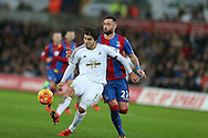 Alberto Paloschi of Swansea city shields the ball from Damien Delaney of Crystal Palace (r).Barclays Premier league match, Swansea city v Crystal Palace at the Liberty Stadium in Swansea, South Wales on Saturday 6th February 2016.<br /> pic by Andrew Orchard, Andrew Orchard sports photography.