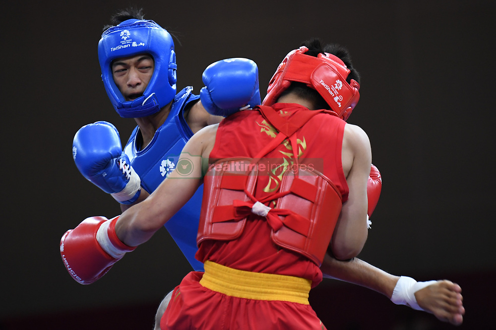 JAKARTA, Aug. 19, 2018  Jason Goh (L) of Singapore competes with Kan Kai Wa of China's Macao during Men's Sanda-56kg Round of 32 in the 18th Asian Games in Jakarta, Indonesia, Aug. 19, 2018. Kan Kai Wa won 2-0. (Credit Image: © Pan Yulong/Xinhua via ZUMA Wire)