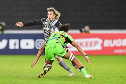 Ospreys' Jeff Hassler is tackled by Northampton Saints' Lewis Ludlam<br /> <br /> Photographer Craig Thomas/Replay Images<br /> <br /> EPCR Champions Cup Round 4 - Ospreys v Northampton Saints - Sunday 17th December 2017 - Parc y Scarlets - Llanelli<br /> <br /> World Copyright © 2017 Replay Images. All rights reserved. info@replayimages.co.uk - www.replayimages.co.uk