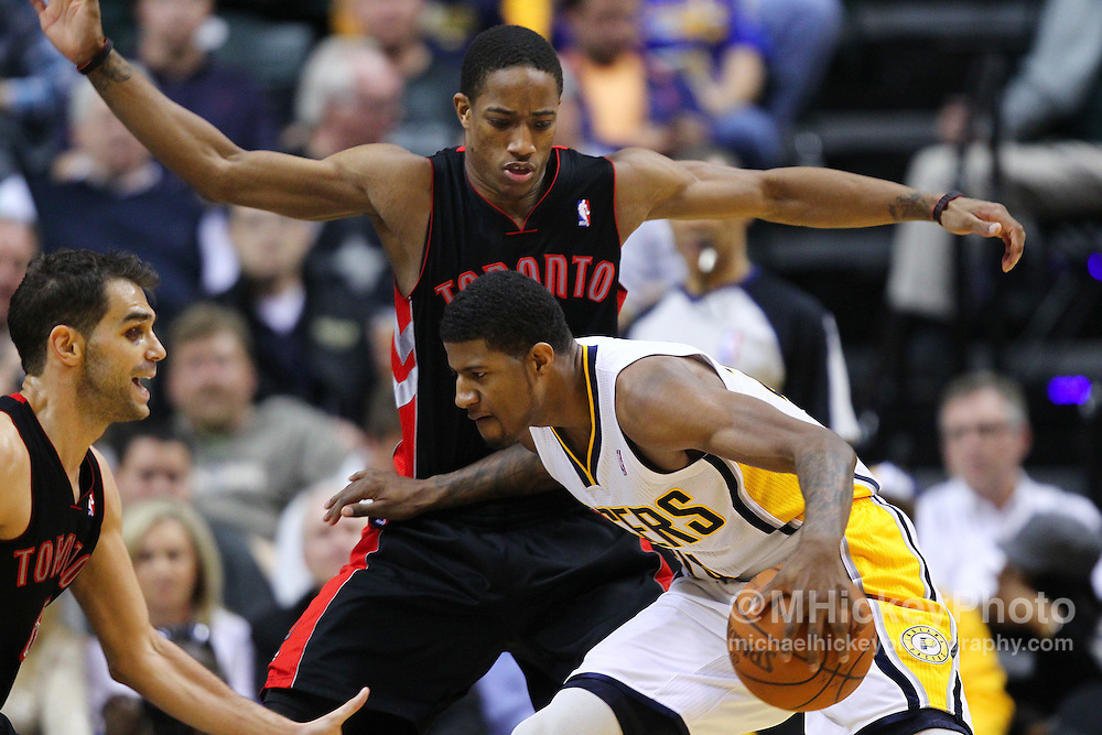 April 09, 2012; Indianapolis, IN, USA; Indiana Pacers shooting guard Paul George (24) dribbles against Toronto Raptors shooting guard DeMar DeRozan (10) at Bankers Life Fieldhouse. Indiana defeated Toronto 103-98. Mandatory credit: Michael Hickey-US PRESSWIRE