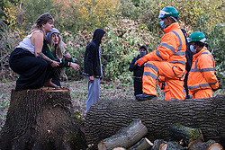 Denham, UK. 29th September, 2020. Security guards working on behalf of HS2 Ltd block environmental activists objecting to the felling of trees in Denham Country Park for works connected to the HS2 high-speed rail link. Anti-HS2 activists based at the nearby Denham Ford Protection Camp and protesting against the destruction of the woodland contend that the area of Denham Country Park currently being felled is not indicated for felling on documentation supplied by HS2 Ltd.