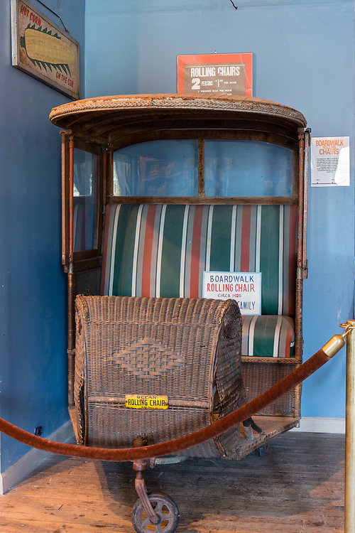 A boardwalk rolling chair made by the Ocean Rollling Chair Co. in the Coney Island Museum.