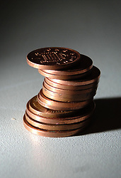 Embargoed to 0001 Friday May 03 File photo dated 07/03/07 of a stack of copper coins. Plans to safeguard the future of cash - from copper coins to larger banknotes - have been set out by the Government.