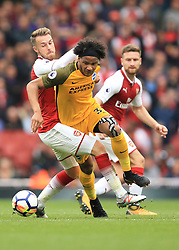 1 October 2017 -  Premier League - Arsenal v Brighton & Hove Albion - Izzy Brown of Brighton and Hove Albion in action with Aaron Ramsey and Shkodran Mustafi of Arsenal - Photo: Marc Atkins/Offside