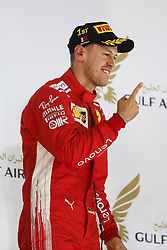 April 8, 2018 - Sakhir, Kingdom of Bahrain - SEBASTIAN VETTEL of Scuderia Ferrari on the podium of the 2018 FIA Formula 1 Bahrain Grand Prix at Bahrain International Circuit in Sakhir, Kingdom of Bahrain. (Credit Image: © James Gasperotti via ZUMA Wire)