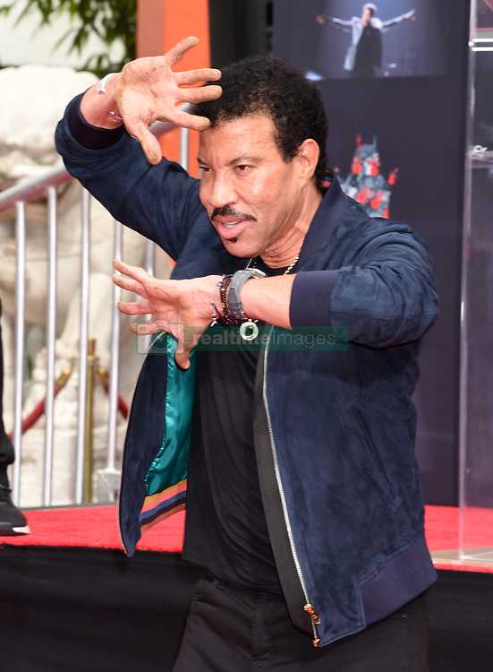 Lionel Richie Handprints and Footprints at the Lionel Richie Hand and Footprints Ceremony at the TCL Chinese Theatre on March 7, 2018 in Hollywood, Ca. © Janet Gough / AFF-USA.COM. 07 Mar 2018 Pictured: Lionel Richie. Photo credit: MEGA TheMegaAgency.com +1 888 505 6342