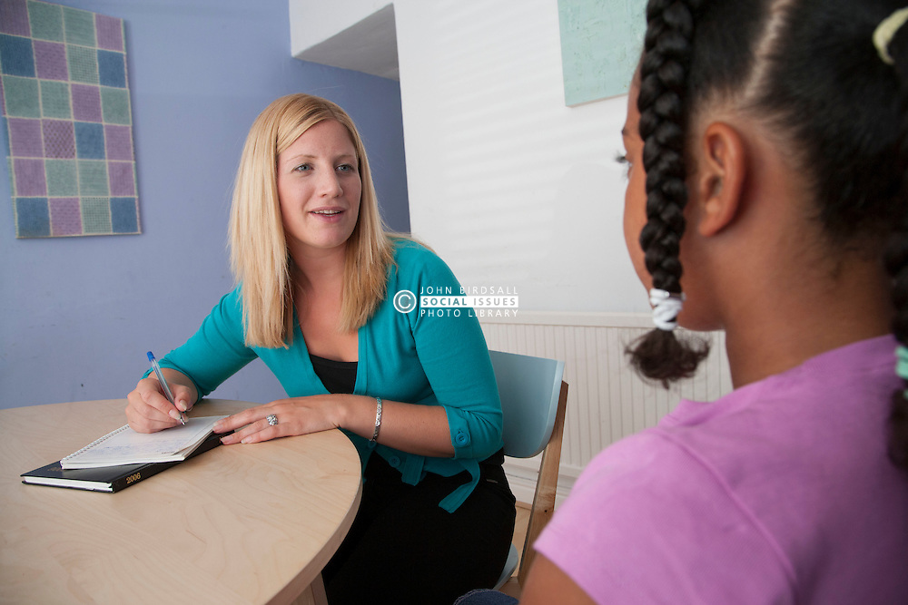 Social worker interviewing child in centre.