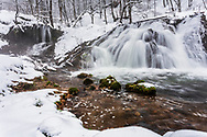 Waterfall in a winter forest