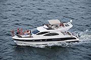 Santos_SP, Brasil...Pessoas passeando de barco no litoral de Santos, Sao Paulo...People traveling by boat in Santos coast, Sao Paulo...Foto: LEO DRUMOND / NITRO