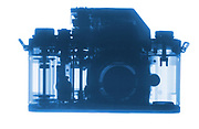 A Nikon F1 camera is shown in X-ray.