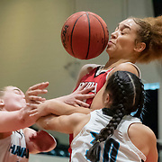 Biola forward Jazz Benn (11) battles for the rebound with Hawai'i Pacific guard Ally Bates (0) and Hawai'i Pacific guard Starr Rivera (30) in the third quarter during a semifinal of the PacWest Women's Basketball Championships in the Felix Event Center at Azusa Pacific University Friday, Mar. 6, 2020, in Azusa. Hawai'i Pacific defeated Biola 68-65. (Mandatory Credit: Sara Nevis-Sports Shooter Academy)