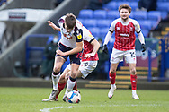 Bolton Wanderers midfielder George Thomason (25) during the EFL Sky Bet League 2 match between Bolton Wanderers and Cheltenham Town at the University of  Bolton Stadium, Bolton, England on 16 January 2021.