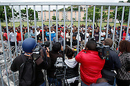 DURBAN - 14 October 2016 - Journalists and cameramen film and listen as a student activist backed by fellow students speaks to media from behind barbed wire that students put out to prevent police from accessing their residence at the University of KwaZulu-Natal's Westville campus. Picture: Allied Picture Press/APP