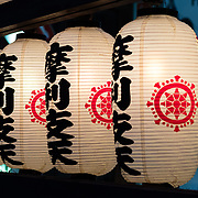 Paper lanterns lighting up a temple.