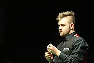 Jackson Page of Wales, a 15 year old from Ebbw Vale in South Wales looks on during his 1st round match against Jason Weston of England. Coral Welsh Open Snooker 2017, day 1 at the Motorpoint Arena in Cardiff, South Wales on Monday 13th February 2017.<br /> pic by Andrew Orchard, Andrew Orchard sports photography.