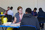 Sarah Murphy, TB Nurse Specialist for Public Health England's London TB Extended Contact Tracing Team (LTBEx) whilst doing a health assessment on a young person as part of tuberculosis contact screening in a community secondary school in London. UK