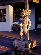 Carved wooden Indian facing the Plaza of Old Town, Albuquerque, New Mexico.