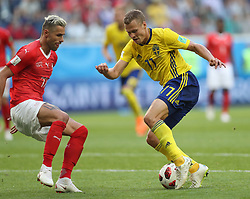 July 3, 2018 - Saint Petersburg, Russia - Valon Behrami (L) of Switzerland vies with Viktor Claesson of Sweden during the 2018 FIFA World Cup round of 16 match between Switzerland and Sweden in Saint Petersburg, Russia, July 3, 2018. Sweden won 1-0 and advanced to the quarter-final. (Credit Image: © Cao Can/Xinhua via ZUMA Wire)
