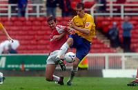 Photo: Henry Browne.<br /> Swindon v Nottingham Forest. Coca Cola League 1.<br /> 13/08/2005.<br /> Scott Dobie of Forest challenges Gareth Whalley of Swindon.