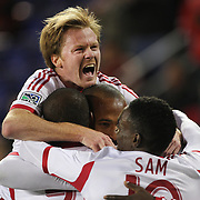 Dax McCarty, (top), New York Red Bulls, jumps on his team mates as they celebrate the second goal from Bradley Wright-Phillips during the New York Red Bulls V Houston Dynamo, Major League Soccer regular season match at Red Bull Arena, Harrison, New Jersey. USA. 23rd April 2014. Photo Tim Clayton