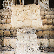 "Carved decorations at the bottom of the stairs of the Acropolis on the northern side of the Ek'Balam archeological site on Mexico's Yucatan Peninsula. It was once a thriving city of Maya Civilization dating to the Late Classic period. It is 30km north of Valladolid and is named for ""Black Jaguar"" a distinctive motif throughout the site."